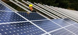 Installing_solar_panels_(3049874118)